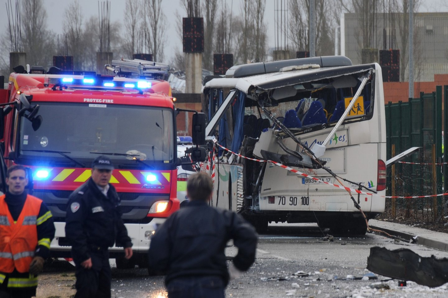A French police officer stands near the wreckage of a school minibus after it crashed into a truck near Rochefort on February 11, 2016, killing at least six children, police said, a day after another road accident involving a school bus left two youngsters dead. The head-on smash with a lorry carrying rubble came around 7:15 am (0615 GMT) near Rochefort in the western Charente-Maritime region. / AFP / XAVIER LEOTY (Photo credit should read XAVIER LEOTY/AFP/Getty Images)