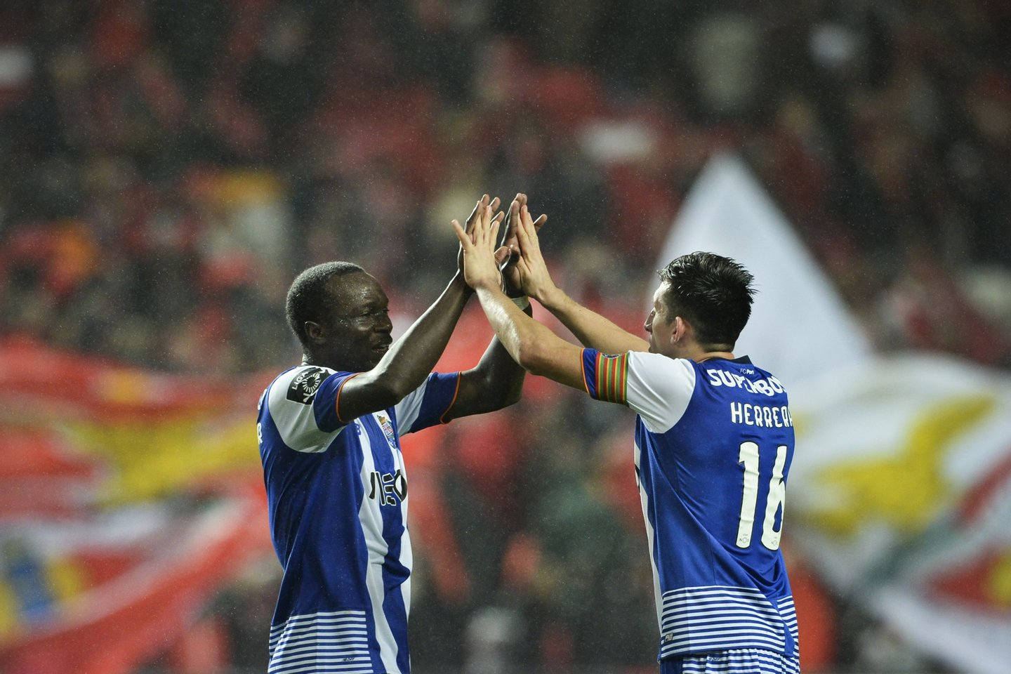 Porto's Cameroonian forward Vincent Aboubakar (L) celebrates a goal with teammate Porto's Mexican midfielder Hector Herrera during the Portuguese league football match SL Benfica vs FC Porto at the Luz stadium in Lisbon on February 12, 2016. / AFP / PATRICIA DE MELO MOREIRA (Photo credit should read PATRICIA DE MELO MOREIRA/AFP/Getty Images)