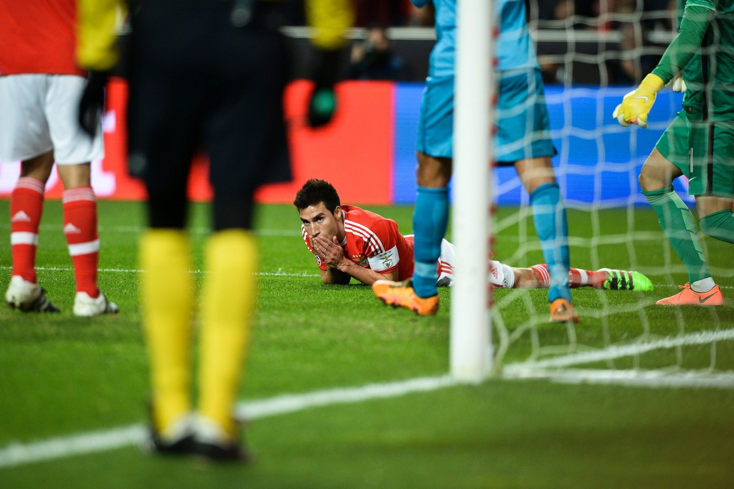 Benfica's Argentine midfielder Nicolas Gaitan lies on the field after a failed attempt on goal during the UEFA Champions League round of 16 football match SL Benfica vs FC Zenith Saint-Petersburg at the Luz stadium in Lisbon on February 16, 2016. / AFP / PATRICIA DE MELO MOREIRA (Photo credit should read PATRICIA DE MELO MOREIRA/AFP/Getty Images)