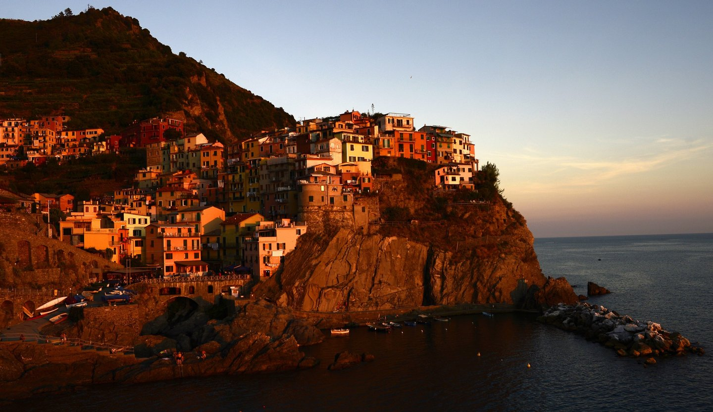 """A general view shows the village of Manarola in the """"Cinque Terre"""" area on September 23, 2013. Wine picking is atypical due to the steep land, close to 50 degrees in some areas. AFP PHOTO / OLIVIER MORIN (Photo credit should read OLIVIER MORIN/AFP/Getty Images)"""