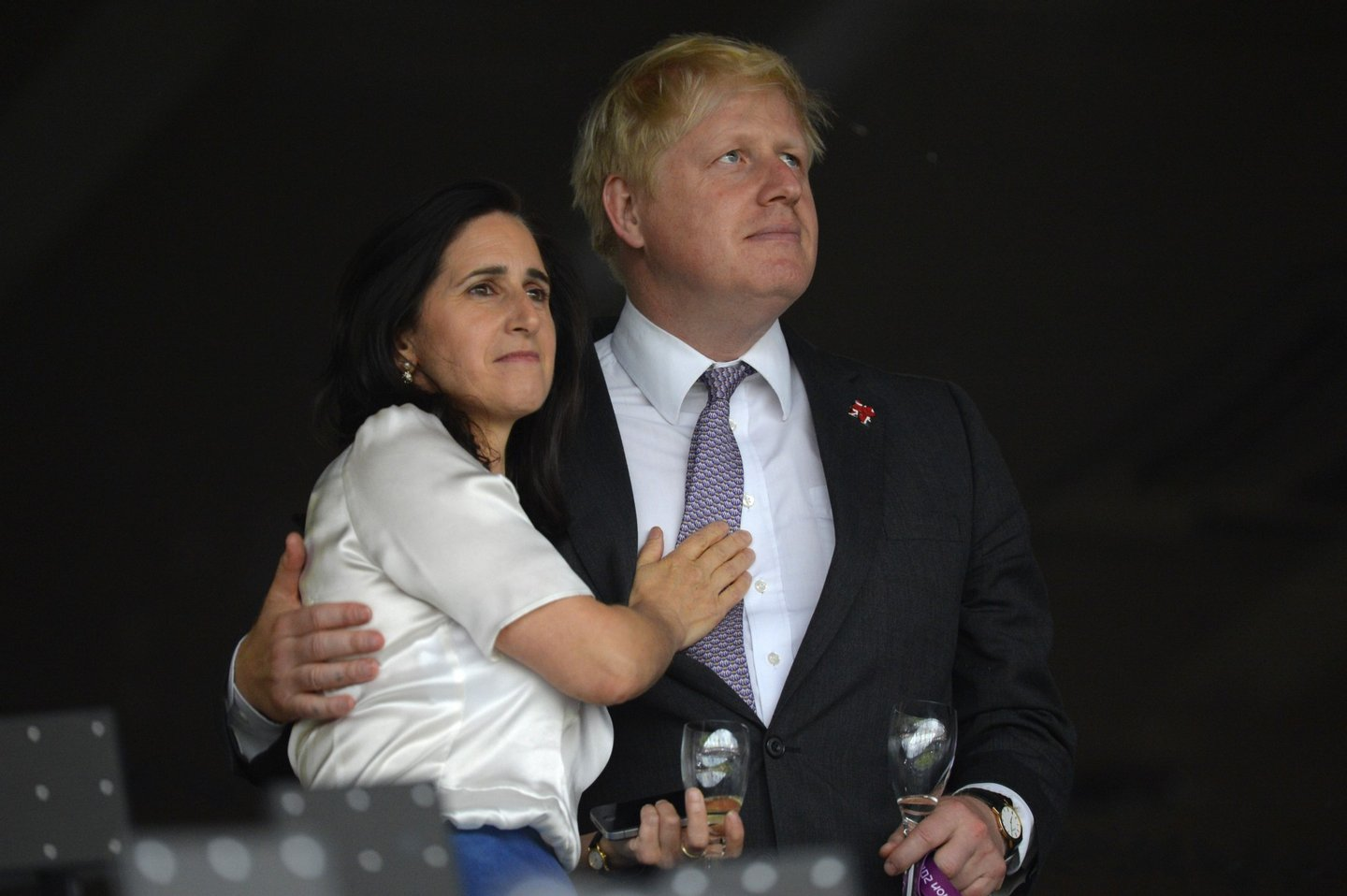 London's Mayor Boris Johnson (R) waits with his wife Marina Wheeler (L) prior to the start of the opening ceremony of the London 2012 Olympic Games on July 27, 2012 at the Olympic Stadium in London. AFP PHOTO / ODD ANDERSEN (Photo credit should read /AFP/GettyImages)