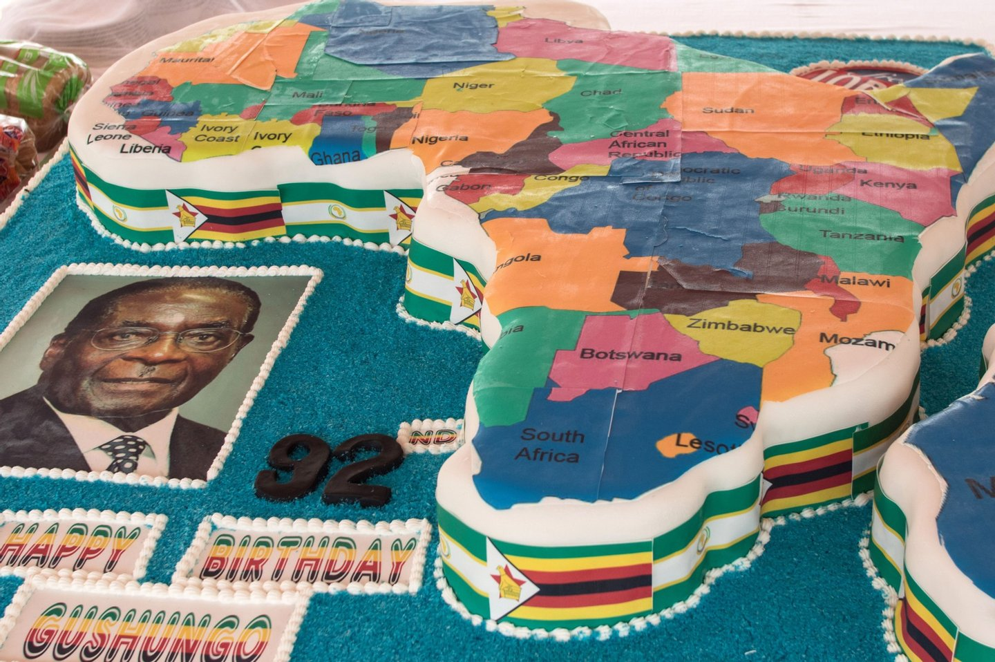 A picture shows Zimbabwean President Robert Mugabe's birthday cake in the shape of the map of Africa during celebrations marking his birthday at the Great Zimbabwe monument in Masvingo on February 27, 2016. / AFP / JEKESAI NJIKIZANA (Photo credit should read JEKESAI NJIKIZANA/AFP/Getty Images)