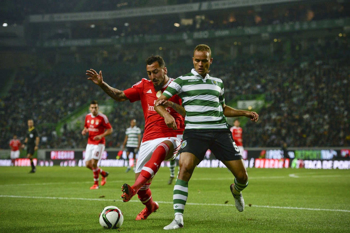 Sporting's Brazilian defender Ewerton (R) vies with Benfica's Greek forward Konstantinos Mitroglou (L) during the Portuguese Cup football match Sporting CP vs SL Benfica Alvalade stadium in Lisbon on November 21, 2015. AFP PHOTO / PATRICIA DE MELO MOREIRA (Photo credit should read PATRICIA DE MELO MOREIRA/AFP/Getty Images)