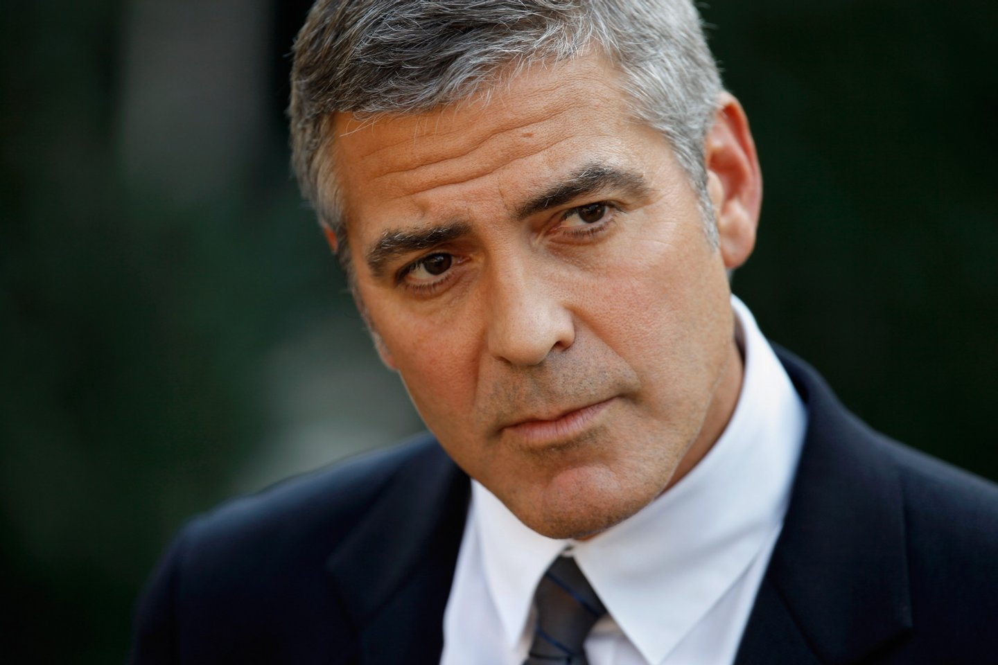 WASHINGTON - OCTOBER 12: Oscar-nominated actor, screen-writer and director George Clooney answers reporters' questions after meeting with U.S. President Barack Obama at the White House October 12, 2010 in Washington, DC. Clooney and human rights activist and co-founder of the Enough Project John Prendergast met with Obama to discuss their recent trip to Sudan and the threat there of a war ahead of a referendum election. (Photo by Chip Somodevilla/Getty Images)