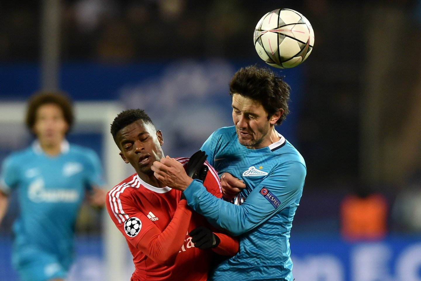 Benfica's defender Nelson Semedo (L) vies for the ball with Zenit's midfielder Yuri Zhirkov during the second-leg round of 16 UEFA Champions League football match FC Zenit vs SL Benfica at the Petrovsky stadium in St. Petersburg on March 9, 2016. AFP PHOTO / KIRILL KUDRYAVTSEV / AFP / KIRILL KUDRYAVTSEV (Photo credit should read KIRILL KUDRYAVTSEV/AFP/Getty Images)