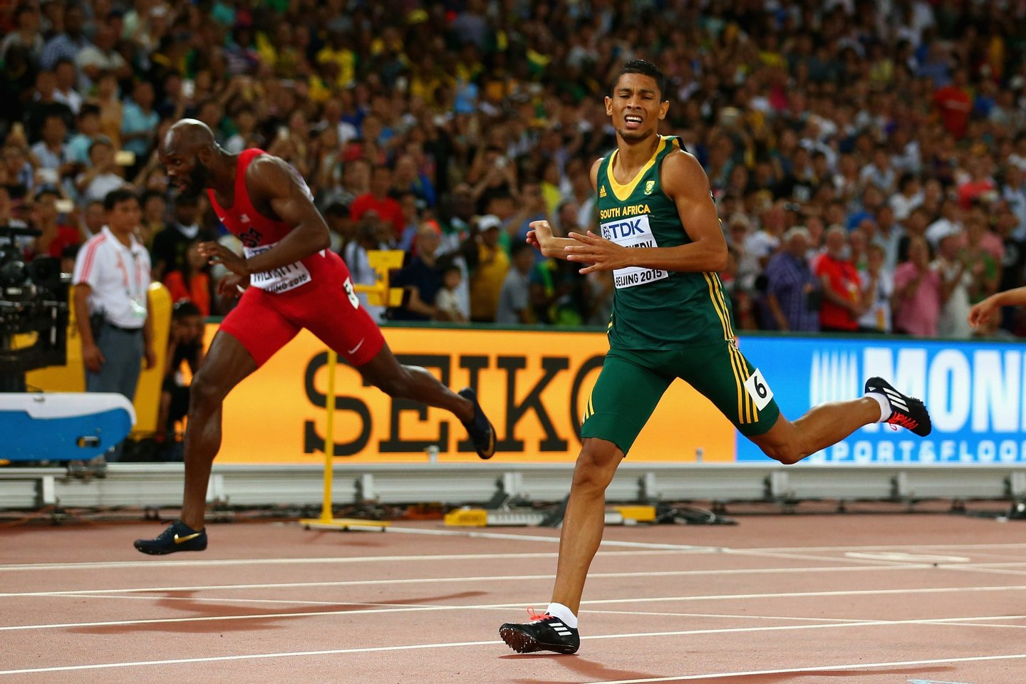 BEIJING, CHINA - AUGUST 26: Wayde Van Niekerk of South Africa (R) crosses the finish line to win gold ahead of Lashawn Merritt of the United States (L) in the Men's 400 metres final during day five of the 15th IAAF World Athletics Championships Beijing 2015 at Beijing National Stadium on August 26, 2015 in Beijing, China. (Photo by Cameron Spencer/Getty Images)