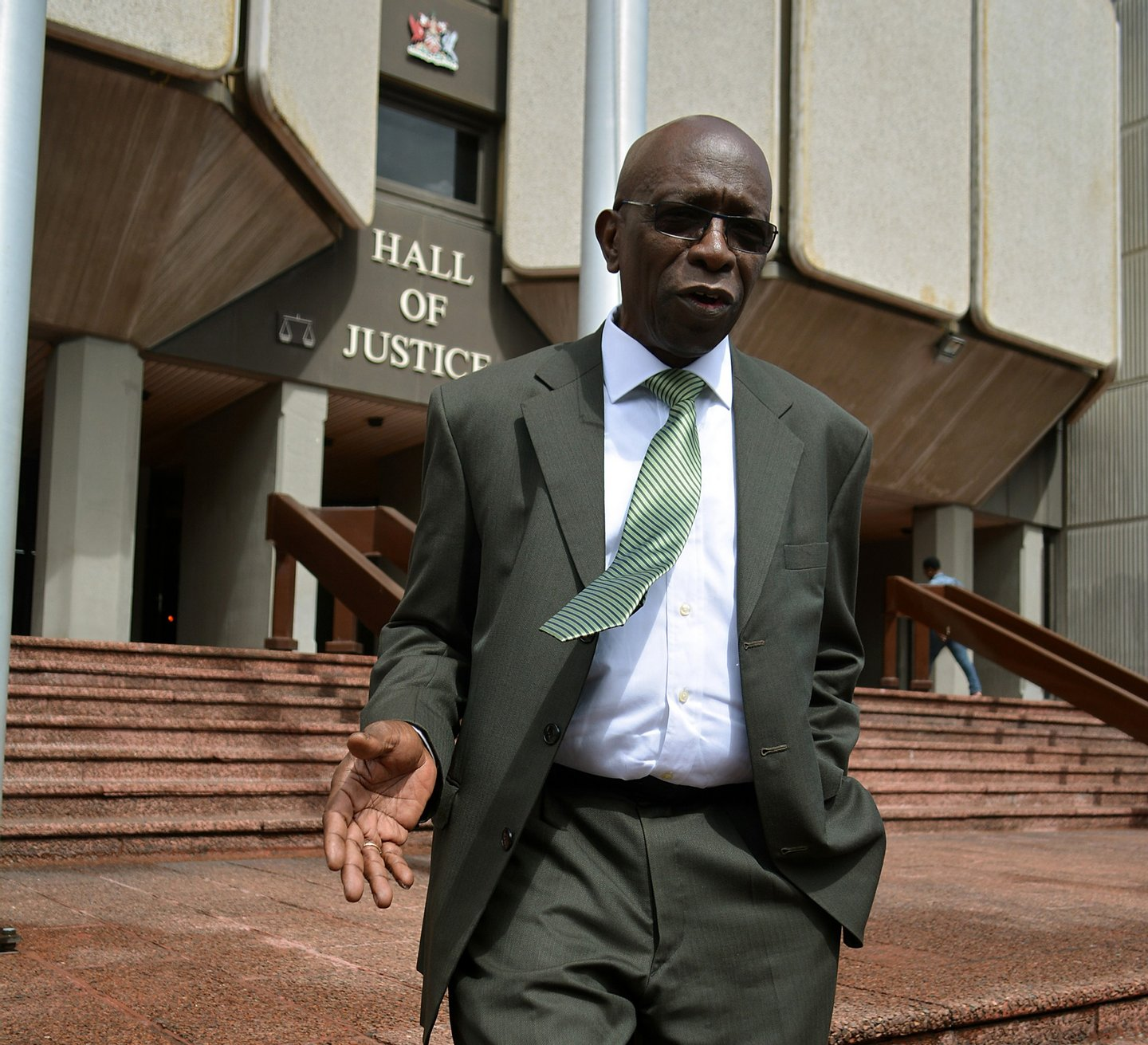 Former FIFA vice-president Jack Warner talks with journalists outside the Hall of Justice in Port-of-Spain, Trinidad, on December 4, 2015, following the hearing of his legal challenge to avert being extradited to the United States where he has been indicted on bribery, racketeering and money laundering charges. AFP photo/ALVA VIARRUEL / AFP / ALVA VIARRUEL (Photo credit should read ALVA VIARRUEL/AFP/Getty Images)
