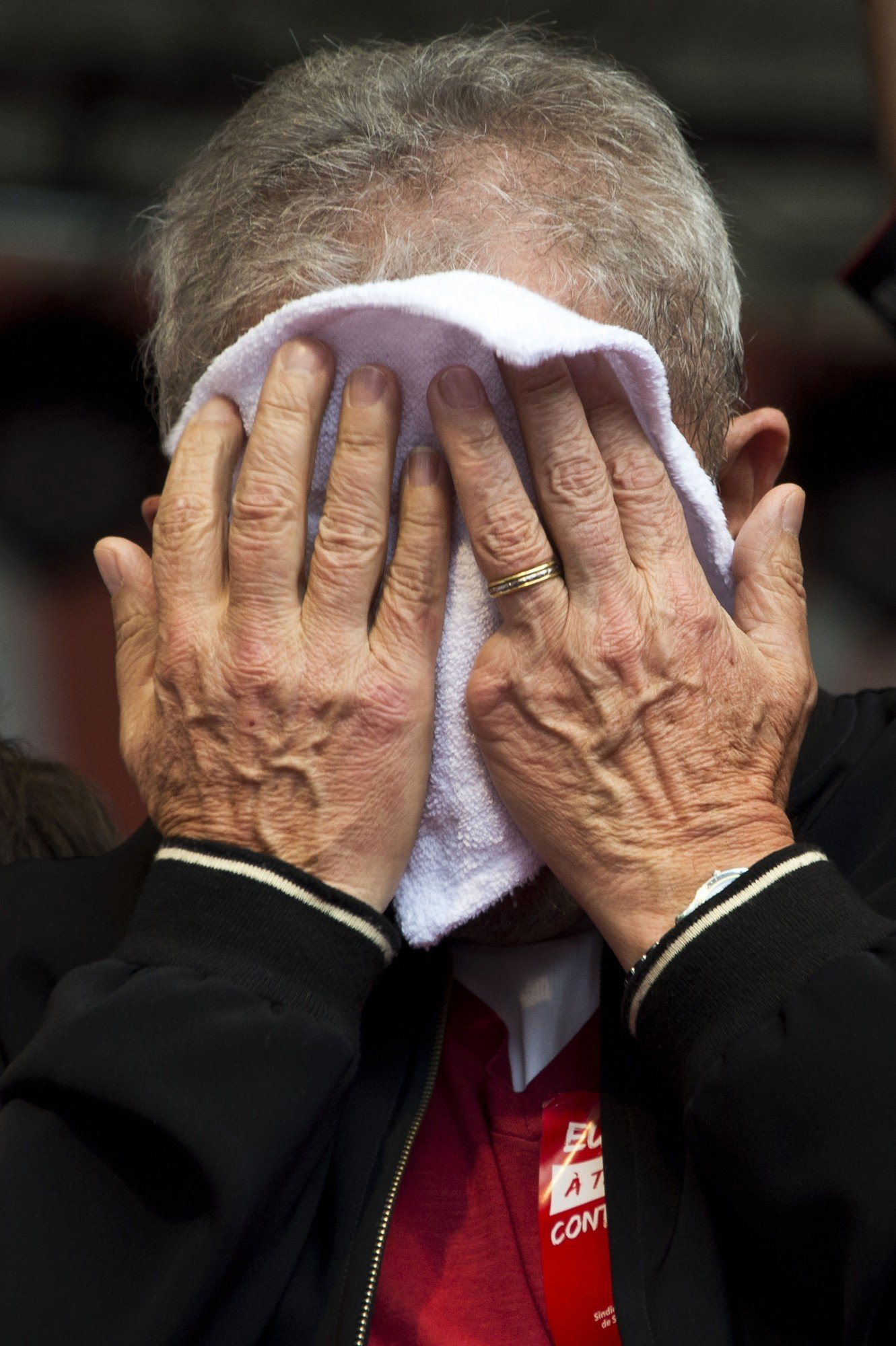 Former Brazilian President Luiz Inacio Lula da Silva wipes his face as he participates in the May Day celebrations in Sao Paulo, Brazil, on May 1, 2015. AFP PHOTO / Nelson ALMEIDA (Photo credit should read NELSON ALMEIDA/AFP/Getty Images)