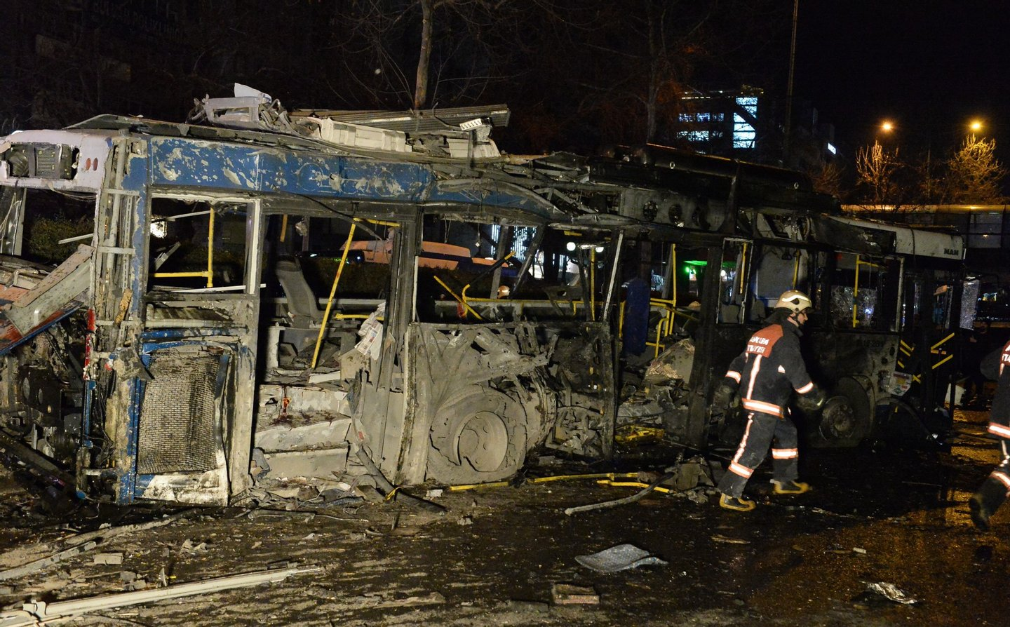 ANKARA, TURKEY - MARCH 13: The wreckage of a bus is seen after an explosion in Ankara's central Kizilay district on March 13, 2016 in Ankara, Turkey. The Ankara governor's office has reported that at least 27 people have been killed and 75 wounded in an explosion in the Turkish capital Ankara. The explosion is believed to have been a car bomb attack according to Ankara governor Mehmet Kiliclar. (Photo by Defne Karadeniz/Getty Images)