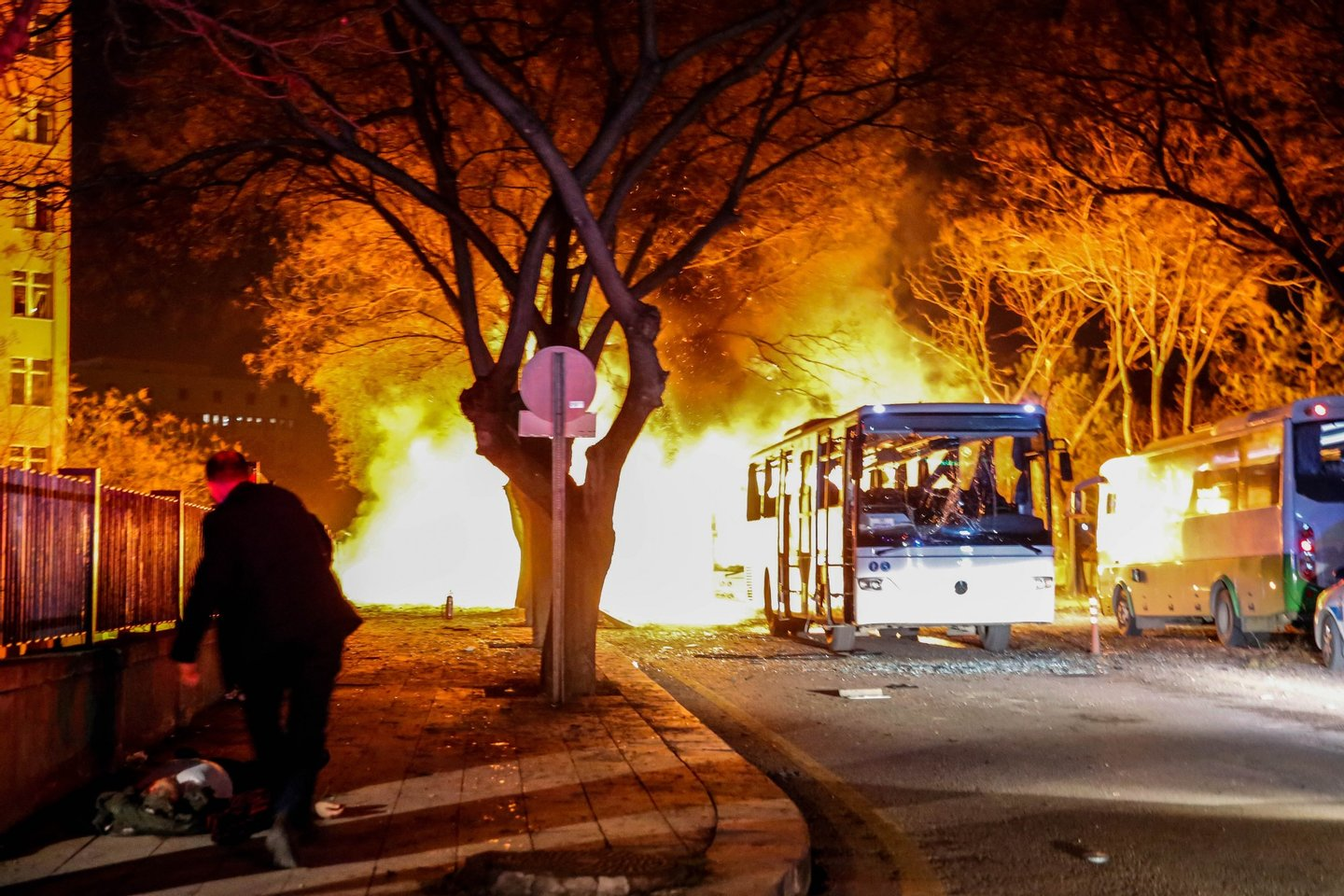 ANKARA, TURKEY - FEBRUARY 17: Turkish army service busses burn after an explosion on February 17, 2016 in Ankara, Turkey. 21 people are believed to have been killed and at least 61 are said to be wounded according to the city's governor Mehmet Kiliclar in what appeared to have been a car bomb attack on a vehicle carrying military personnel in the Turkish capital. (Photo by Defne Karadeniz/Getty Images)