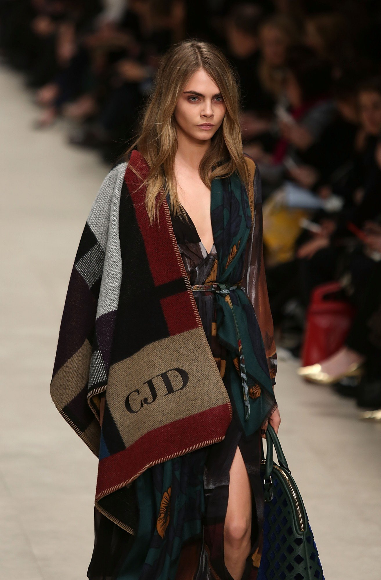 LONDON, ENGLAND - FEBRUARY 17: Model Cara Delevingne walks the runway at the Burberry Prorsum show at London Fashion Week AW14 at Perks Fields, Kensington Gardens on February 17, 2014 in London, England. (Photo by Tim P. Whitby/Getty Images)