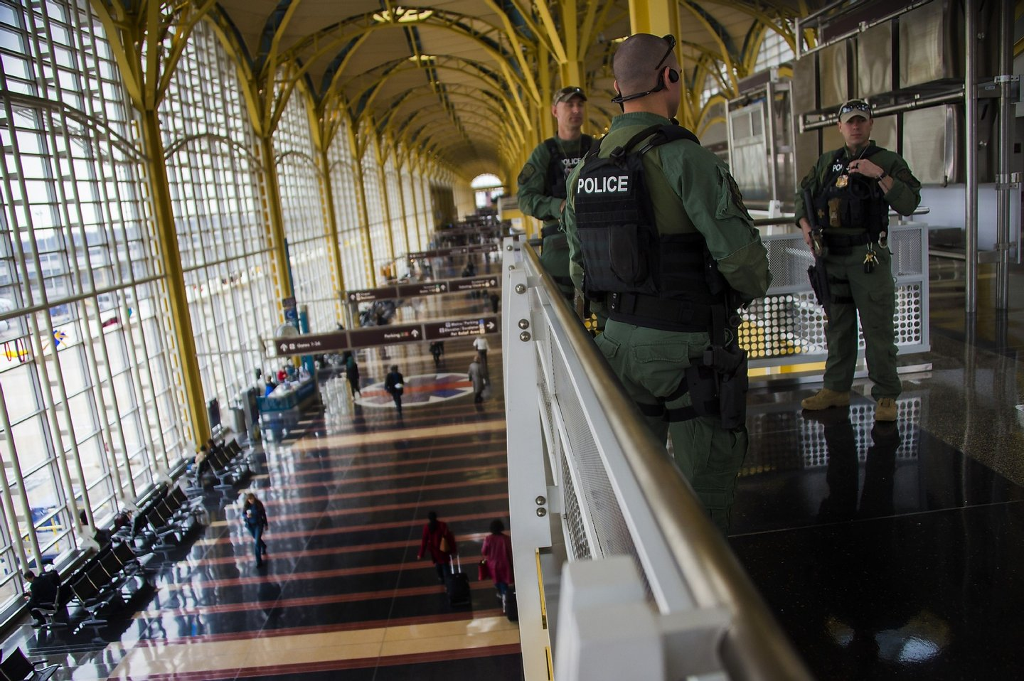 Heavily armed police patrol Ronald Reagan Washington National Airport in Arlington, Virginia, March 22, 2016. New York and Washington stepped up security in the wake of the attacks in Brussels on March 22, deploying counter-terrorism reinforcements and the National Guard to airports and stations, officials said. / AFP / Jim Watson (Photo credit should read JIM WATSON/AFP/Getty Images)