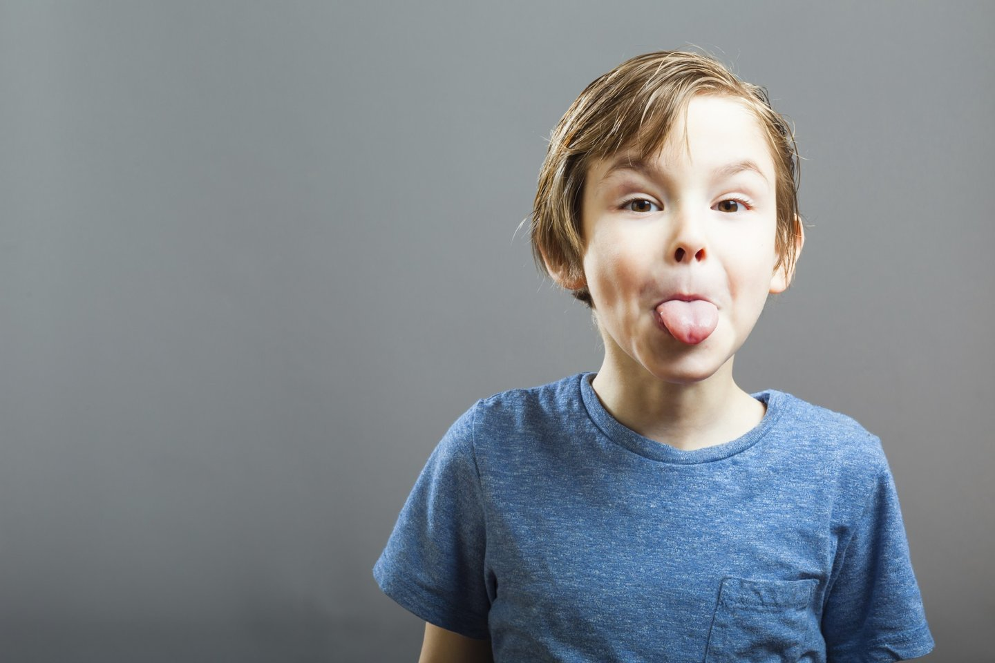 5 years, Gray, background, blue shirt, boy, child, copy space, cute, expression, face, fun, funny, grey, joking, kid, making faces, naughty, one, people, person, portrait, preschooler, sticking out, sticking out tongue, tongue,