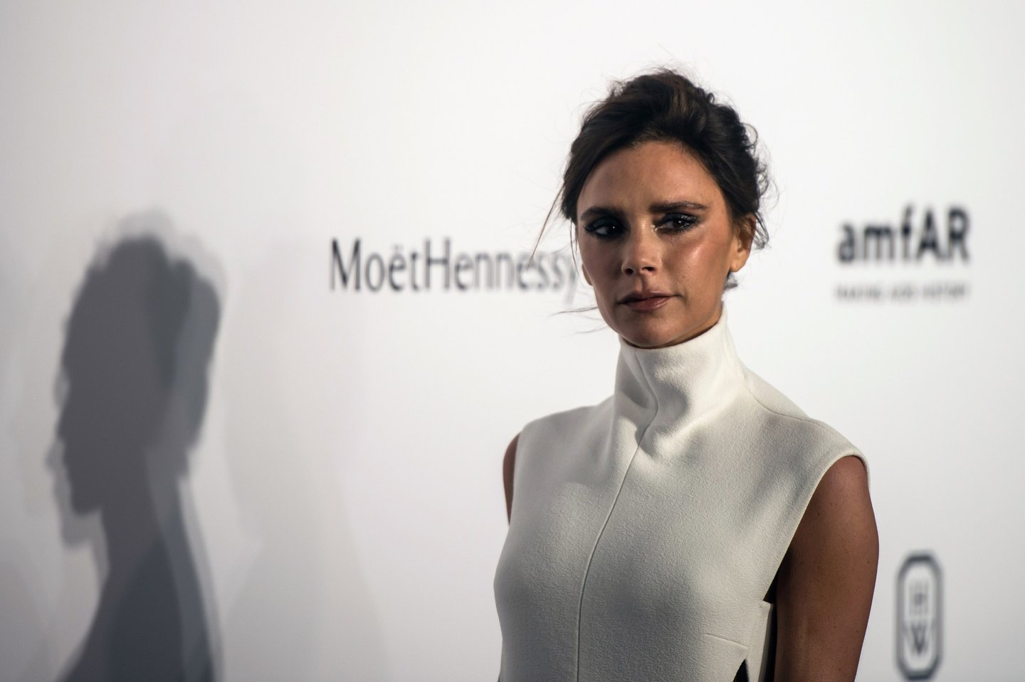 British fashion designer and singer Victoria Beckham poses as she arrives on the red carpet during the 2015 amfAR Hong Kong gala at Shaw Studios in Hong Kong on March 14, 2015. amfAR, The Foundation for AIDS Research, held its inaugural fundraising gala in Hong Kong on March 14. AFP PHOTO / ANTHONY WALLACE (Photo credit should read ANTHONY WALLACE/AFP/Getty Images)