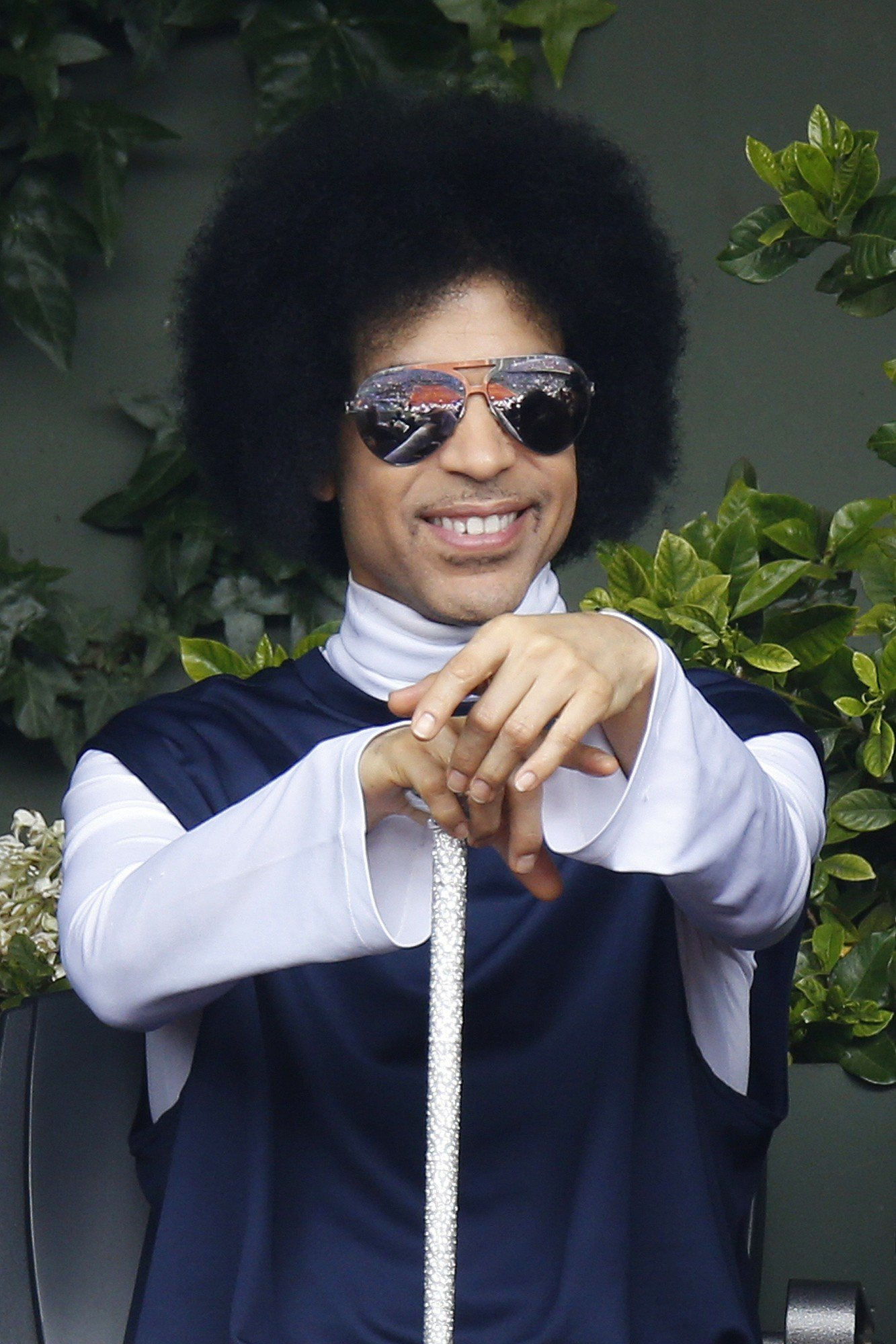 US singer Prince attends the French tennis Open round of sixteen match between Spain's Rafael Nadal and Serbia's Dusan Lajovic at the Roland Garros stadium in Paris on June 2, 2014. AFP PHOTO / KENZO TRIBOUILLARD (Photo credit should read KENZO TRIBOUILLARD/AFP/Getty Images)