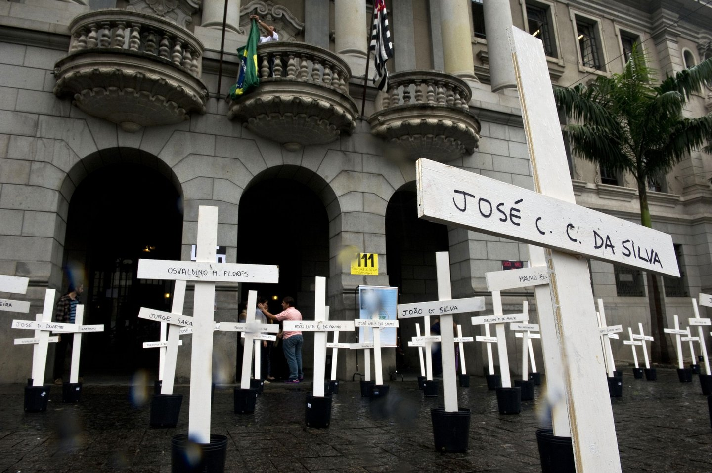 Crosses are seen in front of the School of Law of the University of Sao Paulo (USP) in homage to the inmates dead at the Carandiru Penitentiary massacre in Sao Paulo, Brazil on April 8, 2013. Twenty-six military police officers were to go on trial here Monday for the alleged execution-style killing of inmates during Brazil's deadliest prison uprising, which claimed the lives of 111 prisoners.AFP PHOTO / Nelson ALMEIDA (Photo credit should read NELSON ALMEIDA/AFP/Getty Images)