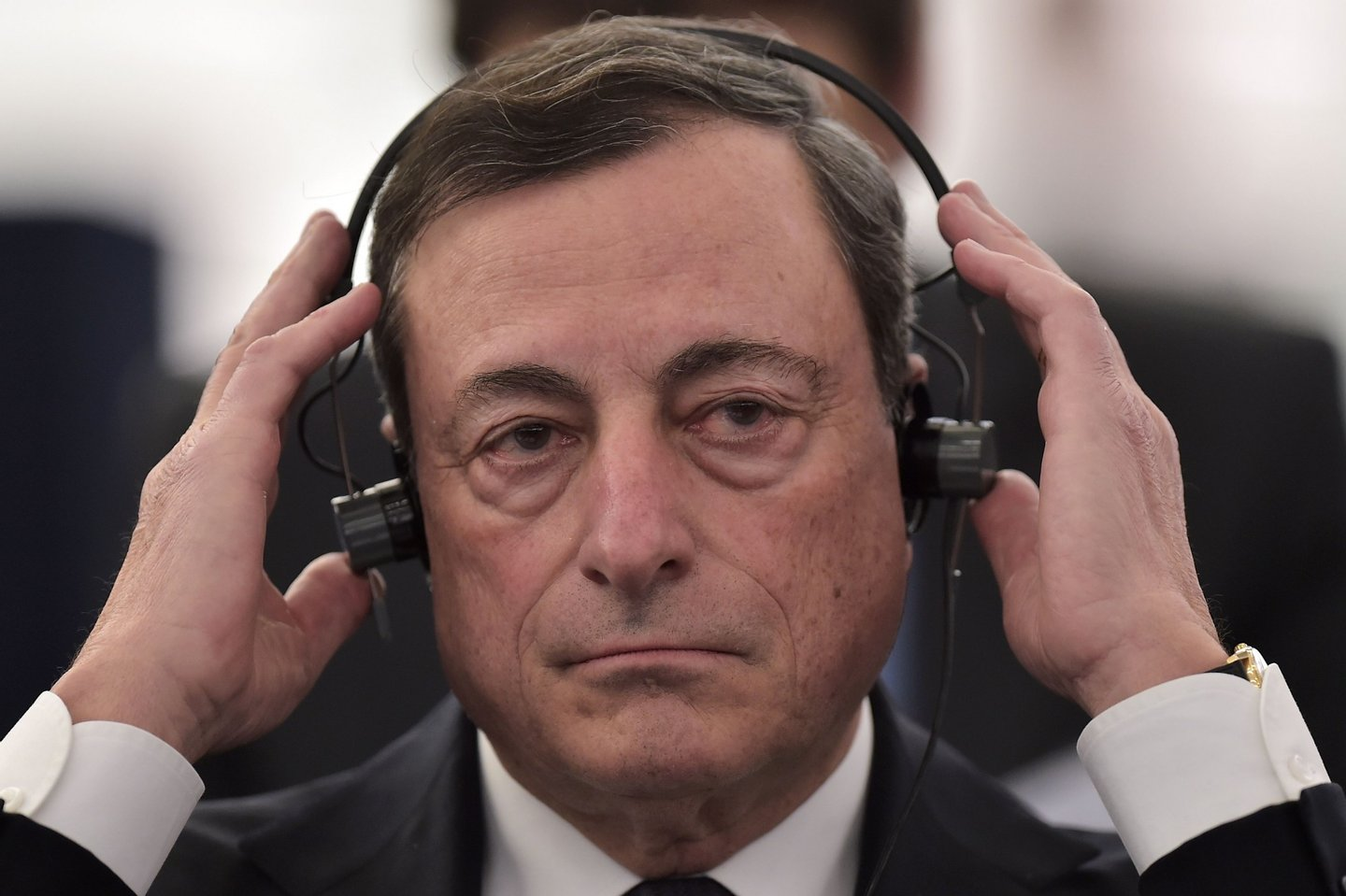 President of the European Central Bank (ECB) Mario Draghi adjusts his headphones as he attends a debate at the European Parliament in Strasbourg, eastern France, on February 1, 2016. / AFP / PATRICK HERTZOG (Photo credit should read PATRICK HERTZOG/AFP/Getty Images)