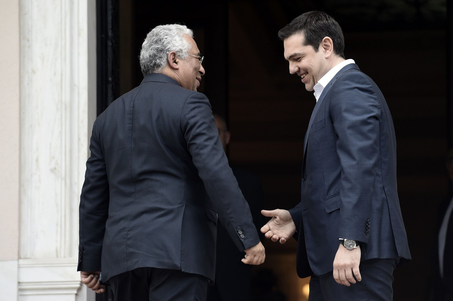 Greek Prime Minister Alexis Tsipras (R) welcomes his Portugese counterpart Antonio Costa prior to their meeting in Athens on April 11, 2016. / AFP / ARIS MESSINIS (Photo credit should read ARIS MESSINIS/AFP/Getty Images)