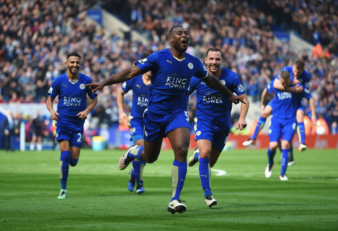 LEICESTER, ENGLAND - APRIL 03: Wes Morgan of Leicester City celebrates with team mates as he scores their first goal during the Barclays Premier League match between Leicester City and Southampton at The King Power Stadium on April 3, 2016 in Leicester, England. (Photo by Michael Regan/Getty Images)