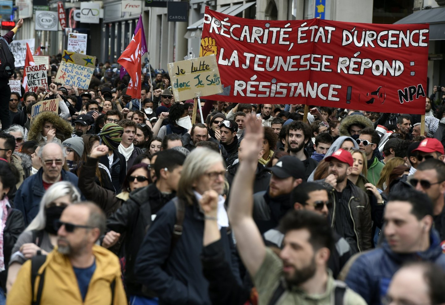 Peole demonstrate against the French government's proposed labour reforms on April 28, 2016 in Lyon, southeastern France. / AFP / PHILIPPE DESMAZES (Photo credit should read PHILIPPE DESMAZES/AFP/Getty Images)