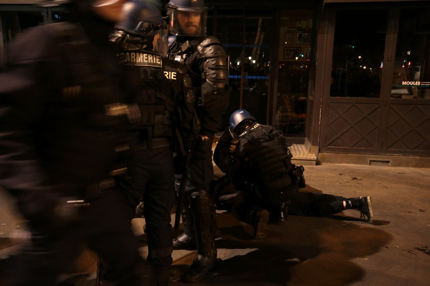 """French Gendarmerie arrest a person as they clear the Place de la Republique in Paris during a protest by the Nuit Debout, or """"Up All Night"""" movement who have been rallying against the French government's proposed labour reforms early on April 29, 2016. Twenty-seven people were arrested and 24 detained during the overnight clashes in the French capital as the police dispersed the protesters who began their began movement on March 31 in opposition to the government's proposed labour reforms. AFP PHOTO / JOEL SAGET / AFP / JOEL SAGET (Photo credit should read JOEL SAGET/AFP/Getty Images)"""