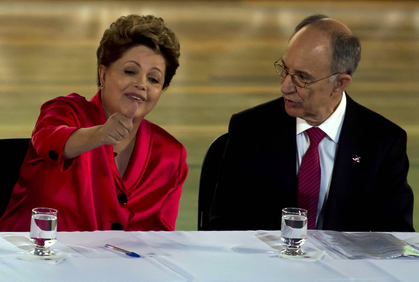 Brazilian President Dilma Rousseff (L) gestures next to Rui Falcao, president of the Workers Party (PT), during celebrations to mark the 34th anniversary of the founding of the Workers Party (PT) in Sao Paulo, Brazil on February 10, 2014. AFP PHOTO / NELSON ALMEIDA (Photo credit should read NELSON ALMEIDA/AFP/Getty Images)