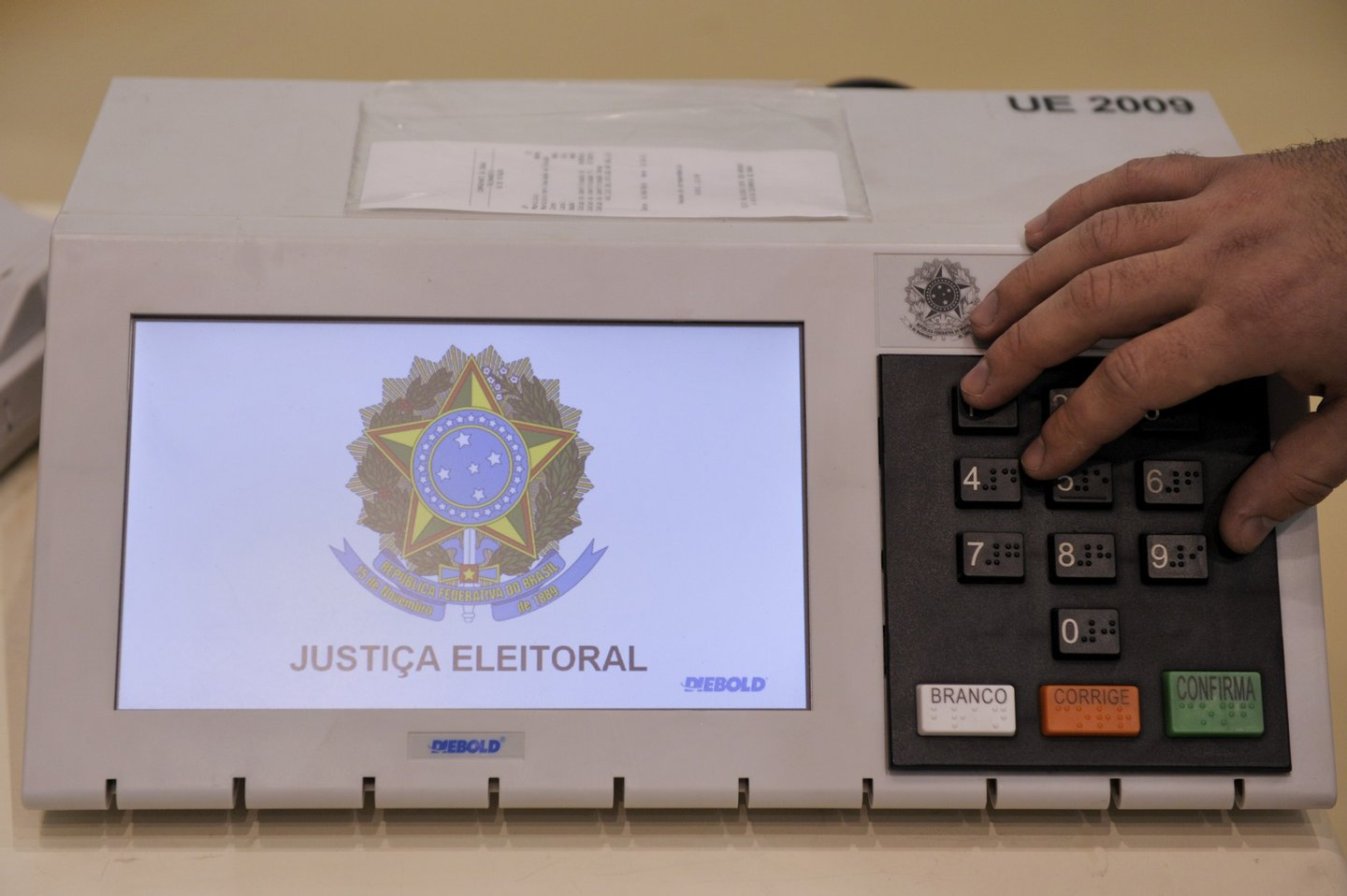 Brazilian researchers demonstrate how to carry out a series of simulated tests to certify the that the electronic voting machines to be used in next October's election work according to the requirements and are not submitted to any fraudulent manipulation, during a press conference at the National Institute for Space Research (INPE) headquarters, in Sao Jose dos Campos, some 90 km north of Sao Paulo, Brazil, on September 8, 2010. Brazil's general elections are scheduled for October 3. AFP PHOTO/Mauricio LIMA (Photo credit should read MAURICIO LIMA/AFP/Getty Images)