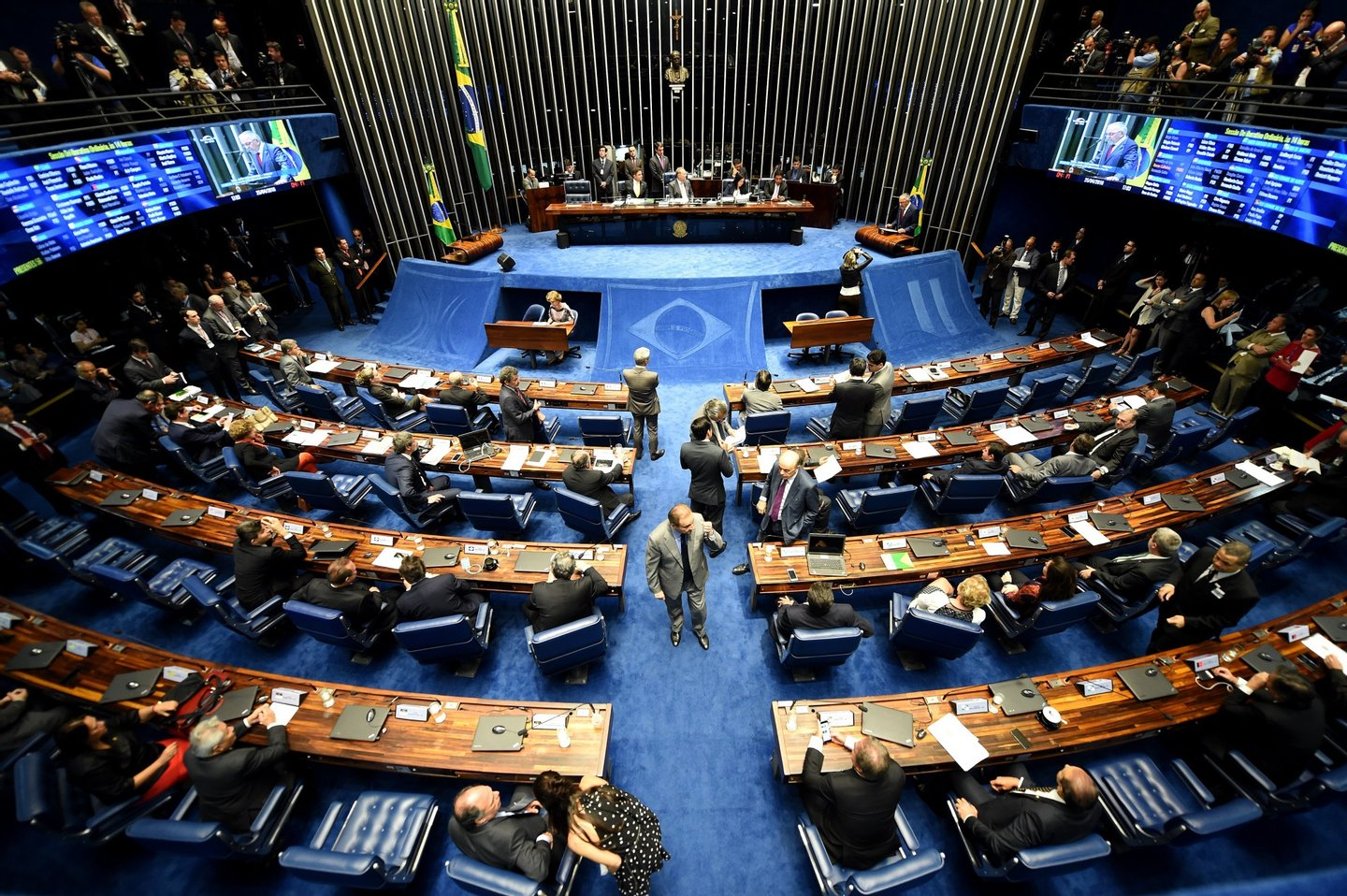 Picture taken during a Brazilian Senate's session to form a committee that will consider whether to impeach President Dilma Rousseff, in Brasilia, on April 25, 2016. Brazil's Senate met Monday to form a committee that will consider whether to impeach Rousseff, who has accused her opponents of mounting a constitutional coup. She is accused of illegal government accounting maneuvers, but says she has not committed an impeachment-worthy crime. The Senate committee -- comprising 21 of the 81 senators -- was to debate Rousseff's fate for up to 10 working days before making a recommendation to the full upper house. / AFP / EVARISTO SA (Photo credit should read EVARISTO SA/AFP/Getty Images)