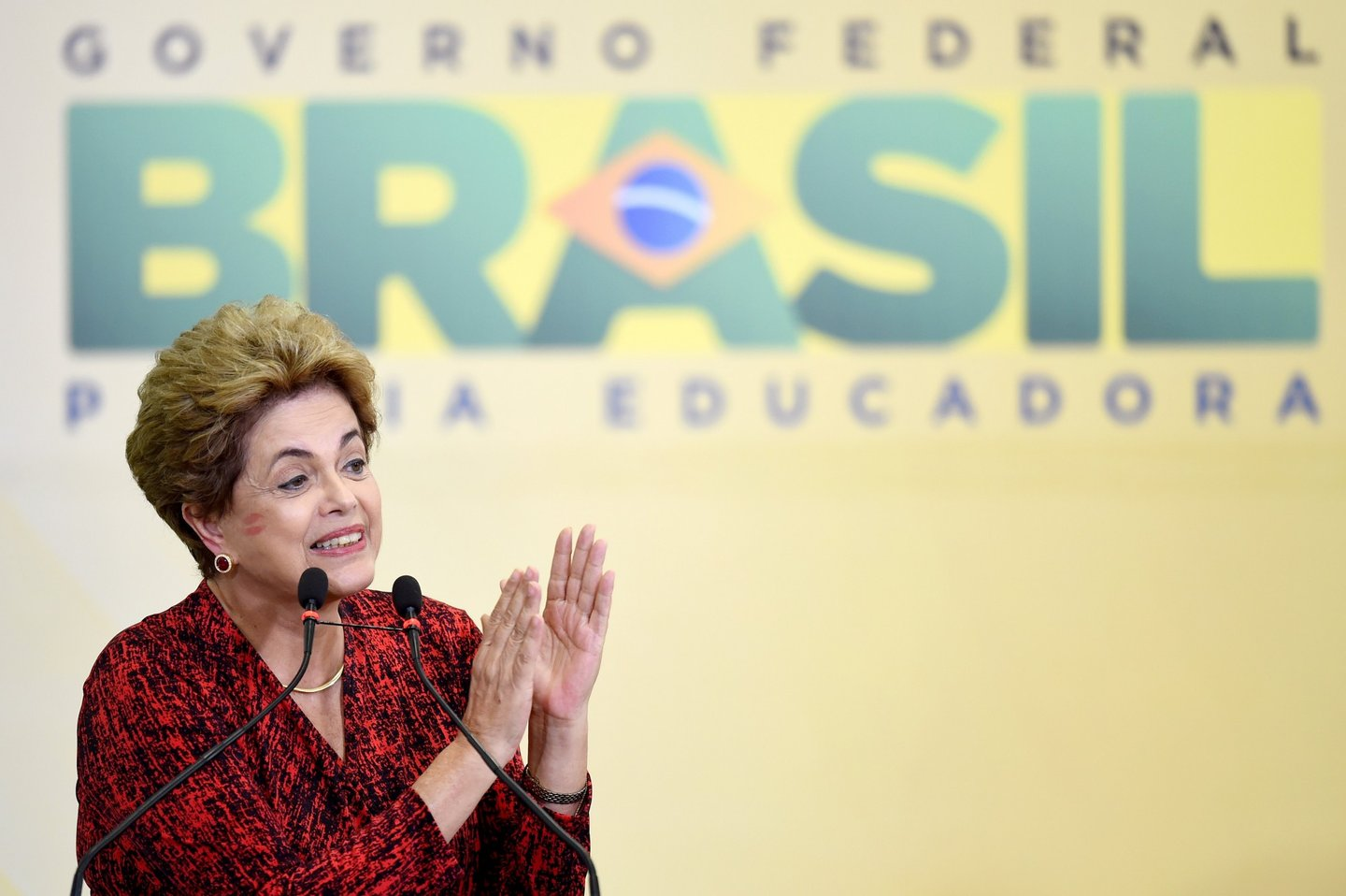 TOPSHOT - Brazilian President Dilma Rousseff during a ceremony to announce the creation of new public universities, at Planalto Palace in Brasilia, on May 9, 2016. The impeachment of Brazilian President Dilma Rousseff was thrown into confusion when Waldir Maranhao, the interim speaker of the lower house of Congress annulled on May 9, 2016 an April vote by lawmakers to launch the process. He wrote in an order that a new vote should take place on whether to impeach Rousseff. / AFP / EVARISTO SA (Photo credit should read EVARISTO SA/AFP/Getty Images)