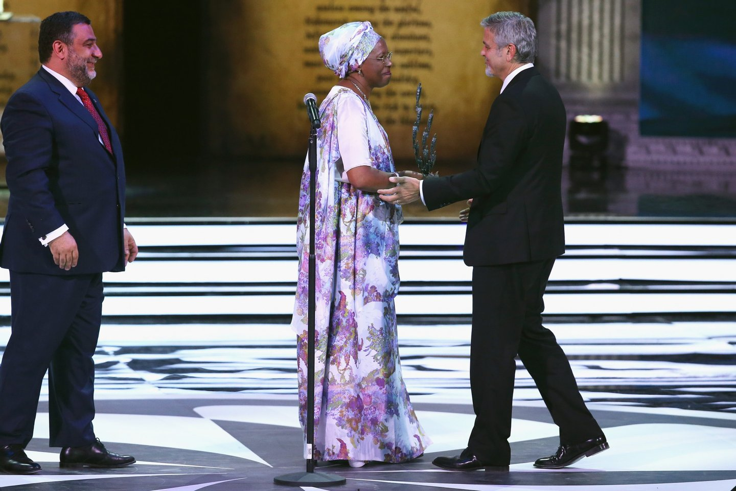 YEREVAN, ARMENIA - APRIL 24:  Aurora Prize Co-Founder Ruben Vardanyan, Aurora Prize finalist and Founder Maison Shalom, Marguerite Barankitse and Aurora Prize  Selection Committee Co-Chair George Clooney on April 24, 2016 in Yerevan, Armenia.  (Photo by Andreas Rentz/Getty Images for 100 Lives)