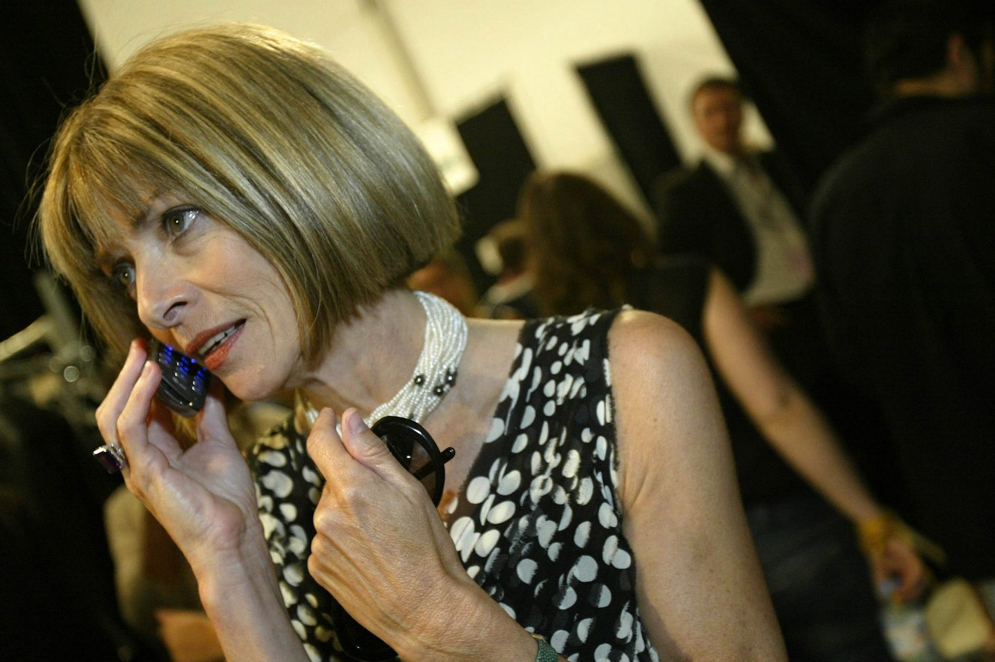 NEW YORK - SEPTEMBER 10: Anna Wintour uses er cell phone backstage during the Zac Posen show during Olympus Fashion Week Spring 2005 at the Theatre in Bryant Park September 10, 2004 in New York City. (Photo by Paul Hawthorne/Getty Images)