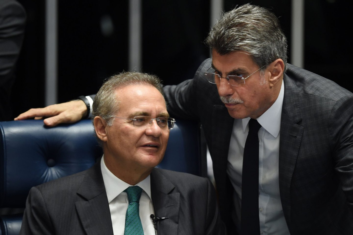 Senate President Renan Calheiros(L) and senator Romero Juca talk during debate Wednesday on suspending and impeaching President Dilma Rousseff in Brasilia on May 11, 2016.  The Senate opened debate that could bring down the curtain on 13 years of leftist rule in Latin America's biggest country. Even allies of Rousseff, 68, said she had no chance of surviving the vote.  / AFP / EVARISTO SA        (Photo credit should read EVARISTO SA/AFP/Getty Images)