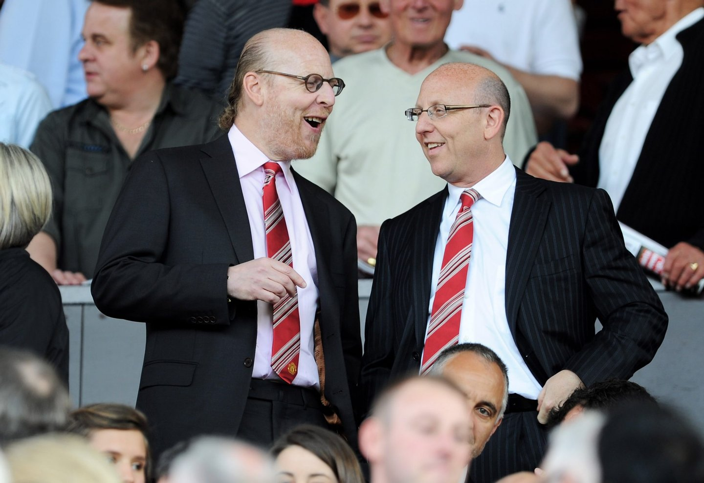 MANCHESTER, ENGLAND - APRIL 09: Manchester United Co-Chairmen Joel Glazer (R) and Avram Glazer talk during the Barclays Premier League match between Manchester United and Fulham at Old Trafford on April 9, 2011 in Manchester, England. (Photo by Michael Regan/Getty Images)