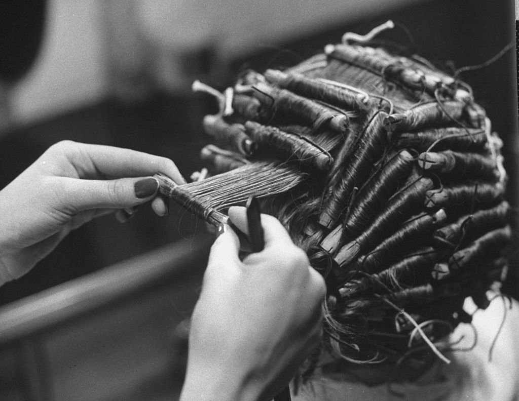 Student setting hair of other student in cosmetology class at, Mergenthaler Vacational-Technical High School. (Photo by Al Fenn//Time Life Pictures/Getty Images)