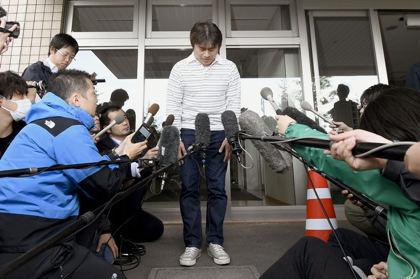Takayuki Tanooka meets with reporters on June 3, 2016, in the northern Japan city of Hakodate, after his 7-year-old son Yamato was found safe after being left behind in mountain forests on May 28 as punishment for misbehaving. The 44-year-old father apologized for trouble he caused. (Photo by Kyodo News via Getty Images)