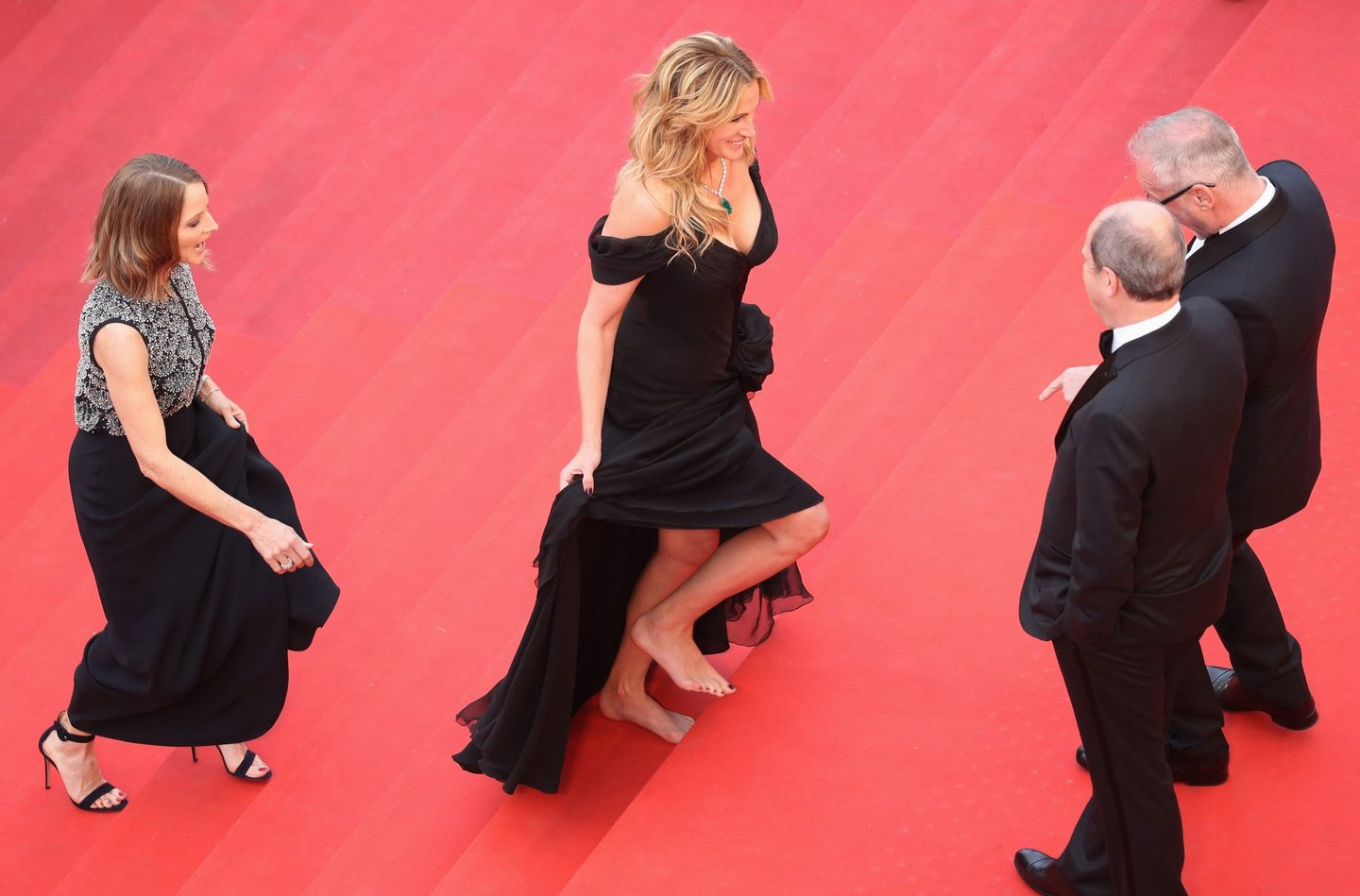CANNES, FRANCE - MAY 12: Producer Jodie Foster (L) and actress Julia Roberts (C) walk up upon their arrival at the 'Money Monster' premiere during the 69th annual Cannes Film Festival at the Palais des Festivals on May 12, 2016 in Cannes, France. (Photo by Andreas Rentz/Getty Images)