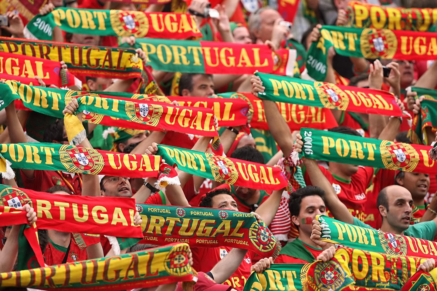 Frankfurt am Main, GERMANY: Portuguese supporters cheer their team prior to the World Cup 2006 group D football game Portugual vs.Iran 17 June 2006 at Frankfurt stadium. AFP PHOTO PATRIK STOLLARZ (Photo credit should read PATRIK STOLLARZ/AFP/Getty Images)