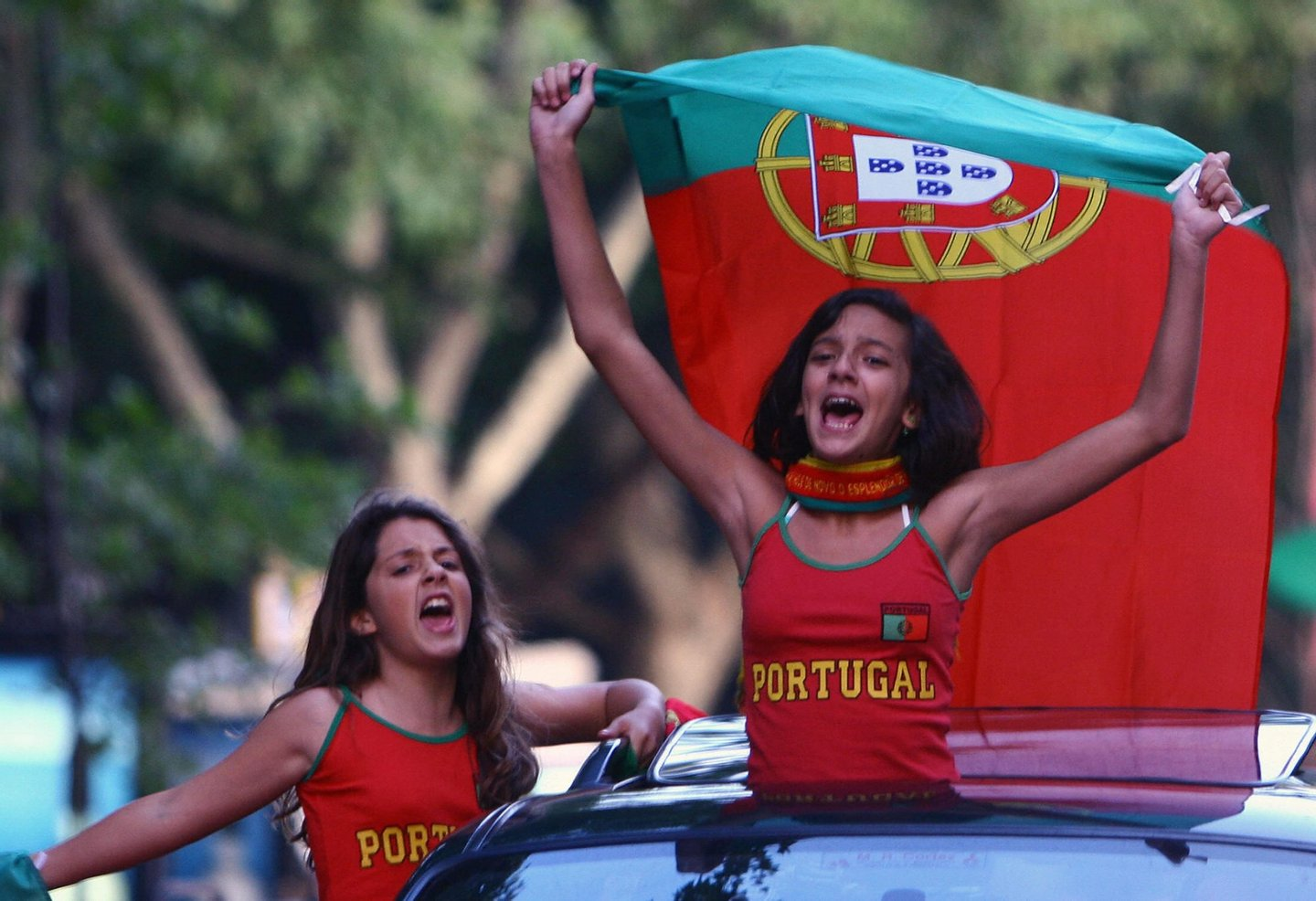 Lisbon, PORTUGAL: Portuguese fans celebrate beating England 1-4 in their World Cup 2006 quarter-final match 01 July 2006 in Lisbon. AFP PHOTO/ FRANCISCO LEONG (Photo credit should read FRANCISCO LEONG/AFP/Getty Images)