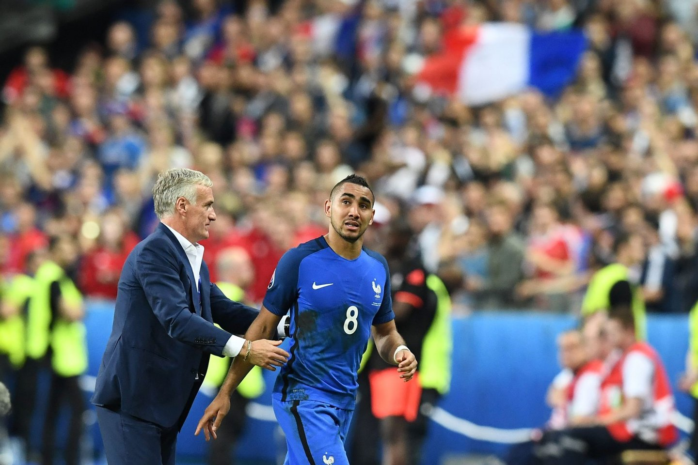 France's forward Dimitri Payet (R) is congratulated by France's coach Didier Deschamps after scoring the 2-1 during the Euro 2016 group A football match between France and Romania at Stade de France, in Saint-Denis, north of Paris, on June 10, 2016. / AFP / FRANCK FIFE        (Photo credit should read FRANCK FIFE/AFP/Getty Images)
