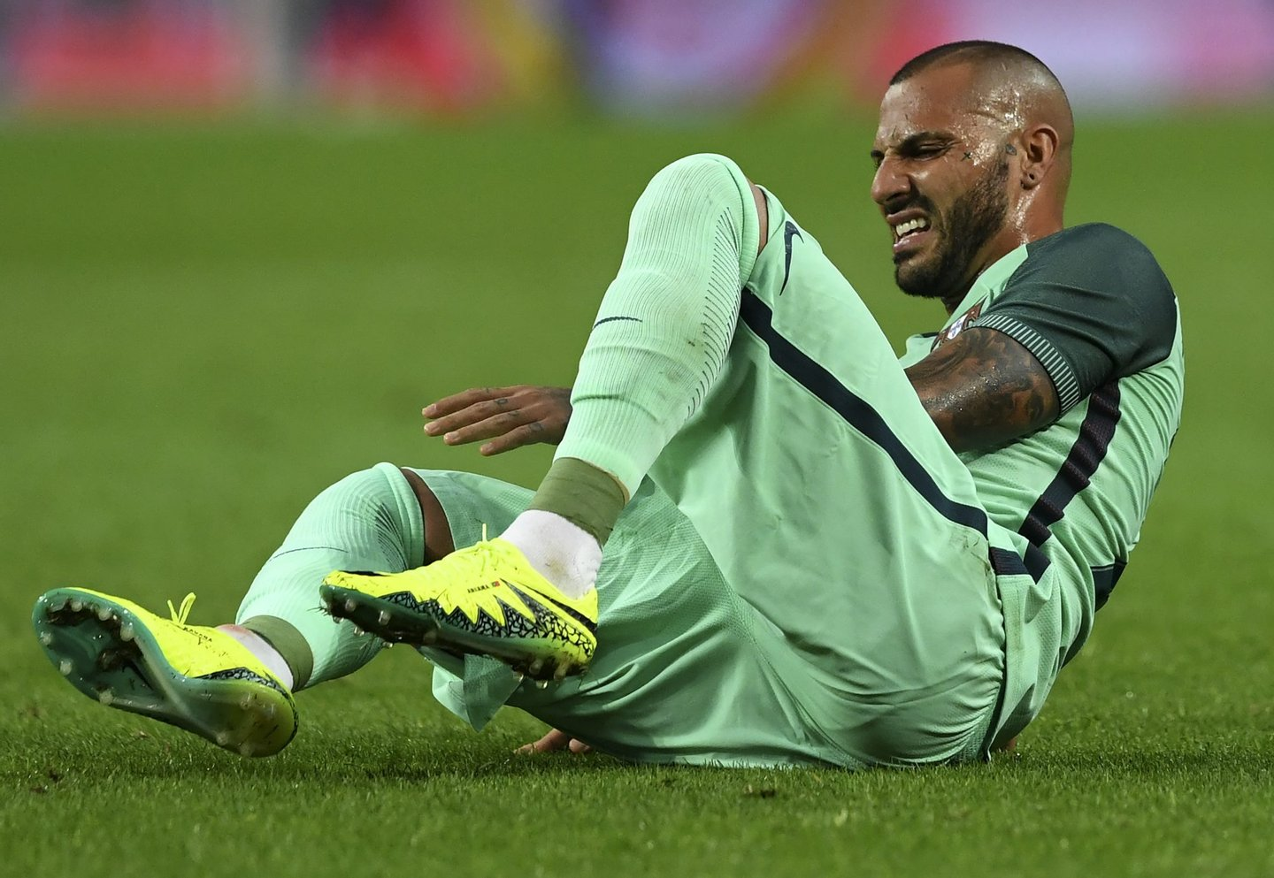 CORRECTION - Portugal's forward Ricardo Quaresma grimaces on the pitch after being takled during the friendly football match Portugal vs Norway at Dragao stadium in Porto on May 29, 2016, in preparation for the upcoming EURO 2016 tournament. / AFP / FRANCISCO LEONG / The erroneous mention[s] appearing in the metadata of this photo by FRANCISCO LEONG has been modified in AFP systems in the following manner: [on May 29, 2016] instead of [on May 28, 2016]. Please immediately remove the erroneous mention[s] from all your online services and delete it (them) from your servers. If you have been authorized by AFP to distribute it (them) to third parties, please ensure that the same actions are carried out by them. Failure to promptly comply with these instructions will entail liability on your part for any continued or post notification usage. Therefore we thank you very much for all your attention and prompt action. We are sorry for the inconvenience this notification may cause and remain at your disposal for any further information you may require.        (Photo credit should read FRANCISCO LEONG/AFP/Getty Images)