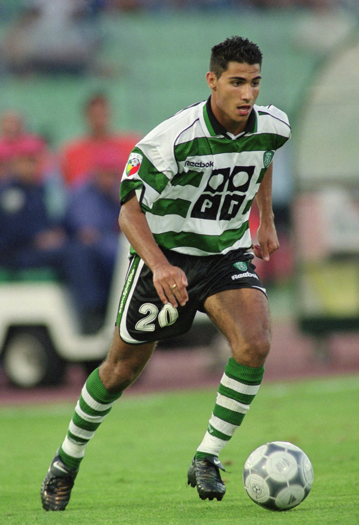 12 Aug 2001: Quaresma of Sporting Lisbon runs with the ball during the Portuguese League match against FC Porto played at the Estadio das Antas, in Porto, Portugal. Sporting Lisbon won the match 1-0. Picture taken by Nuno Correia Mandatory Credit: AllsportUK /Allsport