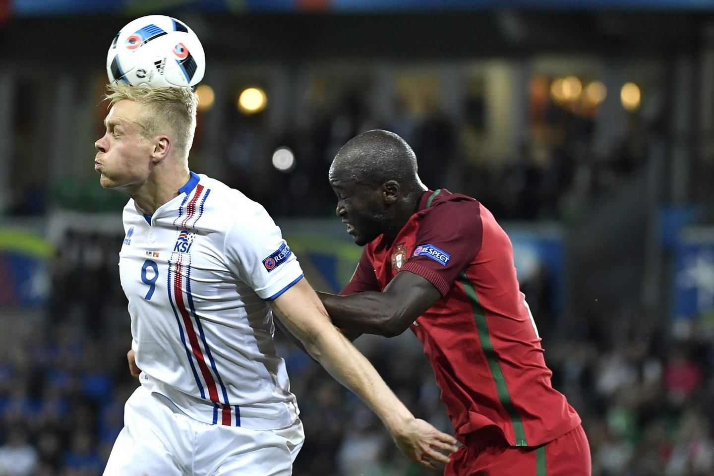 Iceland's forward Kolbeinn Sigthorsson is tackled by Portugal's midfielder Danilo Pereira during the Euro 2016 group F football match between Portugal and Iceland at the Geoffroy-Guichard stadium in Saint-Etienne on June 14, 2016. / AFP / jeff pachoud (Photo credit should read JEFF PACHOUD/AFP/Getty Images)