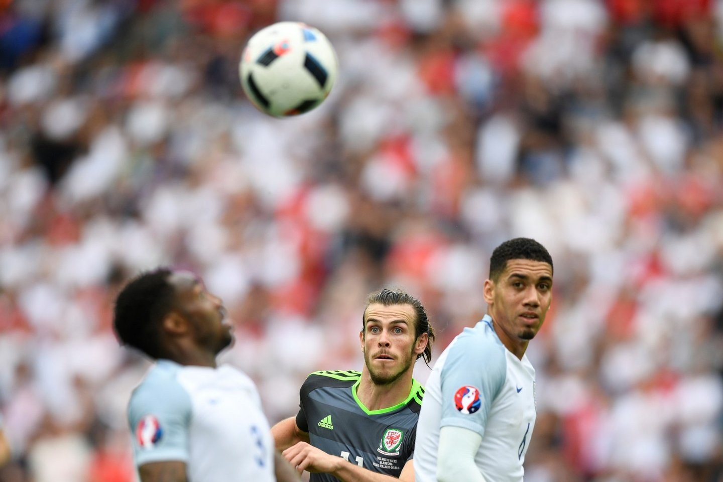 Wales' forward Gareth Bale (C) vies for the ball with England's defender Chris Smalling (R) and England's defender Danny Rose during the Euro 2016 group B football match between England and Wales at the Bollaert-Delelis stadium in Lens on June 16, 2016. / AFP / MARTIN BUREAU (Photo credit should read MARTIN BUREAU/AFP/Getty Images)