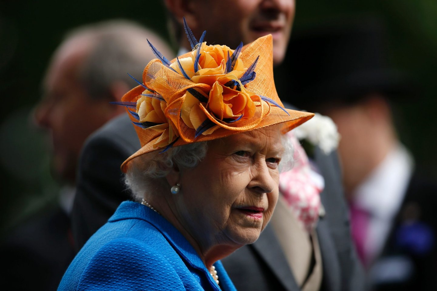 Britain's Queen Elizabeth II looks on during the presentation ceremony for the Gold Cup during Ladies' day at Royal Ascot horse racing meet in Ascot, west of London on June 16, 2016. The five-day meeting is one of the highlights of the horse racing calendar. Horse racing has been held at the famous Berkshire course since 1711 and tradition is a hallmark of the meeting. Top hats and tails remain compulsory in parts of the course while a daily procession of horse-drawn carriages brings the Queen to the course. / AFP / ADRIAN DENNIS (Photo credit should read ADRIAN DENNIS/AFP/Getty Images)
