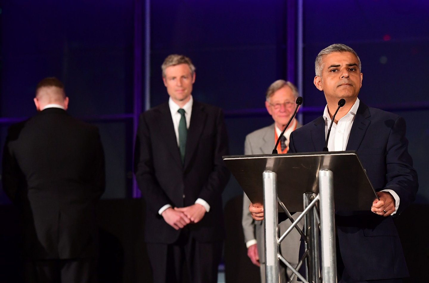 London's new Mayor Sadiq Khan (R) addresses the media as Paul Golding (Far L) the candidate for Britain First, turns his back during the address at City Hall in central London on May 7, 2016. London became the first EU capital with a Muslim mayor Friday as Sadiq Khan won the election that saw his opposition Labour party suffer nationwide setbacks. / AFP / LEON NEAL (Photo credit should read LEON NEAL/AFP/Getty Images)