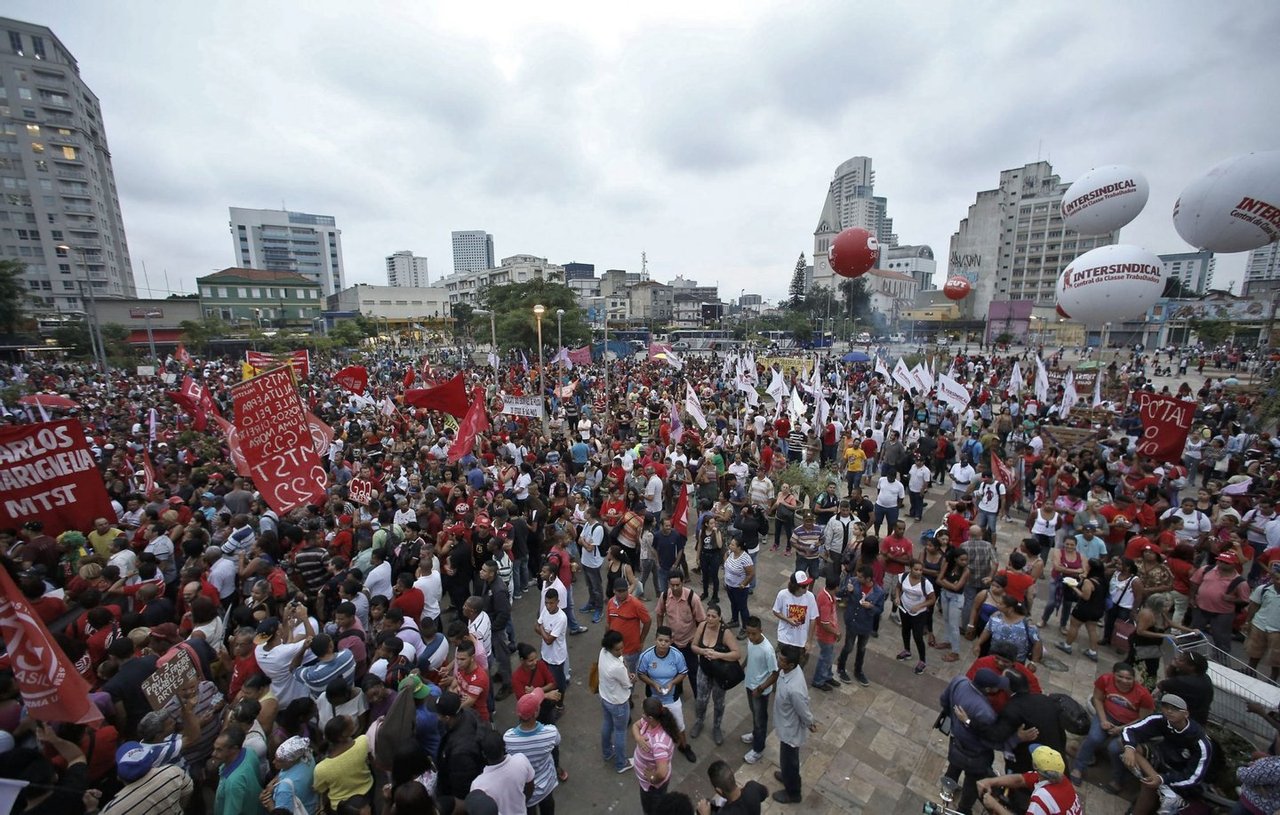 Members of the Landless Workers Movement (MTST) take part in a demonstration in Sao Paulo, Brazil on March 24, 2016. An MTST demonstration to defend a program of reforms, the demilitarization of the police and democracy took place Thursday in Sao Paulo. AFP PHOTO / Miguel SCHINCARIOL / AFP / Miguel Schincariol (Photo credit should read MIGUEL SCHINCARIOL/AFP/Getty Images)