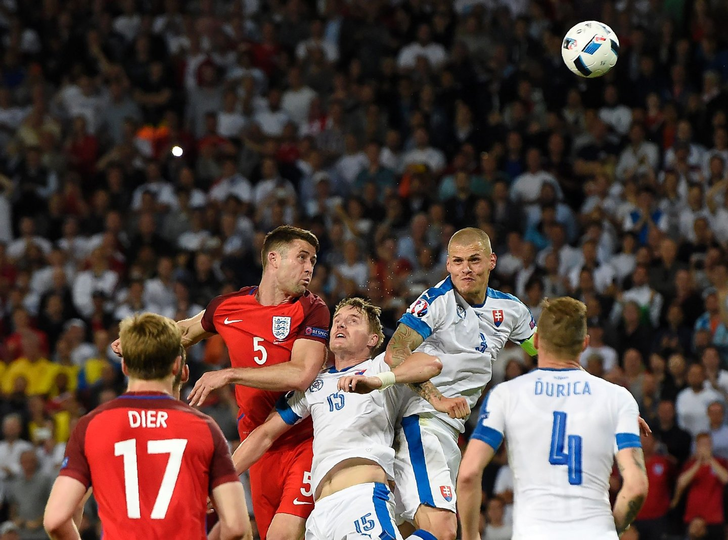 England's defender Gary Cahill (C-L) vies for the header with Slovakia's defender Tomas Hubocan (C) and Slovakia's defender Martin Skrtel (C-R) during the Euro 2016 group B football match between Slovakia and England at the Geoffroy-Guichard stadium in Saint-Etienne on June 20, 2016. / AFP / Joe KLAMAR (Photo credit should read JOE KLAMAR/AFP/Getty Images)
