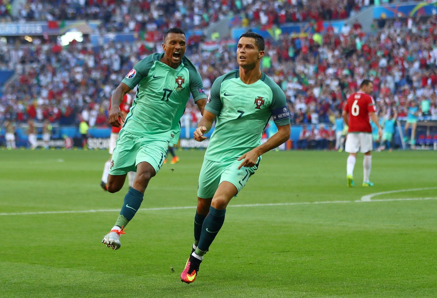 LYON, FRANCE - JUNE 22: Cristiano Ronaldo (R) of Portugal celebrates scoring his team's second goal with his team mate Nani (L) during the UEFA EURO 2016 Group F match between Hungary and Portugal at Stade des Lumieres on June 22, 2016 in Lyon, France. (Photo by Michael Steele/Getty Images)