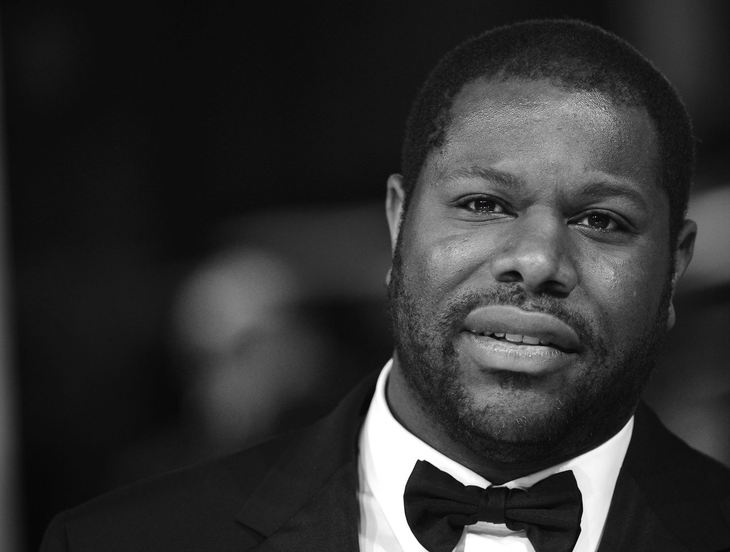 LONDON, ENGLAND - FEBRUARY 16: (EDITORS NOTE: Image has been converted to black and white.) Steve McQueen attends the EE British Academy Film Awards 2014 at The Royal Opera House on February 16, 2014 in London, England. (Photo by Anthony Harvey/Getty Images)