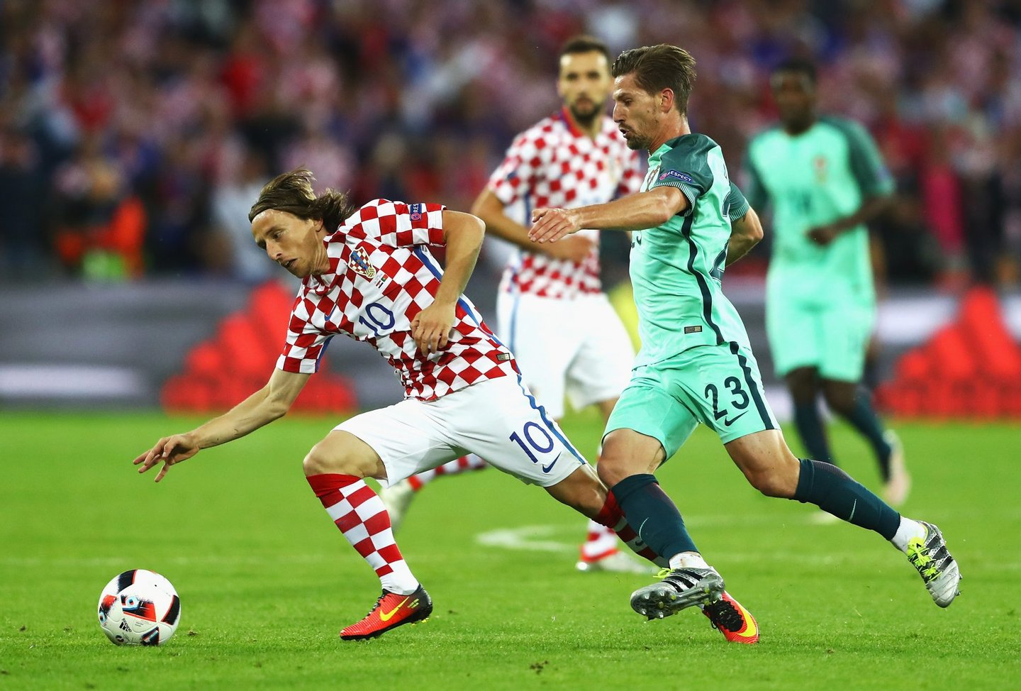 LENS, FRANCE - JUNE 25: Luka Modric of Croatia controls the ball under pressure of Adrien Silva of Portugal during the UEFA EURO 2016 round of 16 match between Croatia and Portugal at Stade Bollaert-Delelis on June 25, 2016 in Lens, France. (Photo by Clive Mason/Getty Images)